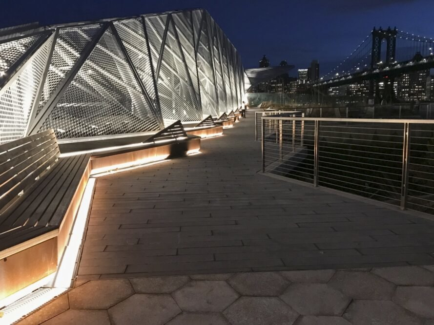 walkway lit by recessed lighting at night