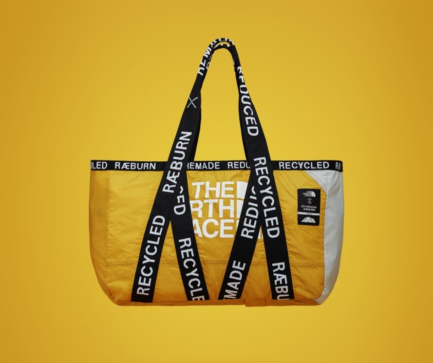yellow tote bag with black straps