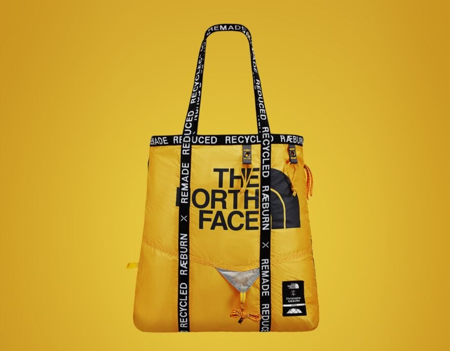 yellow bag with north face logo in front and black straps