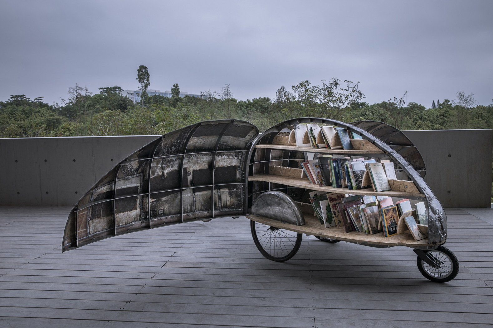 Urban waste is upcycled into an adorable, beetle-shaped micro library on wheels