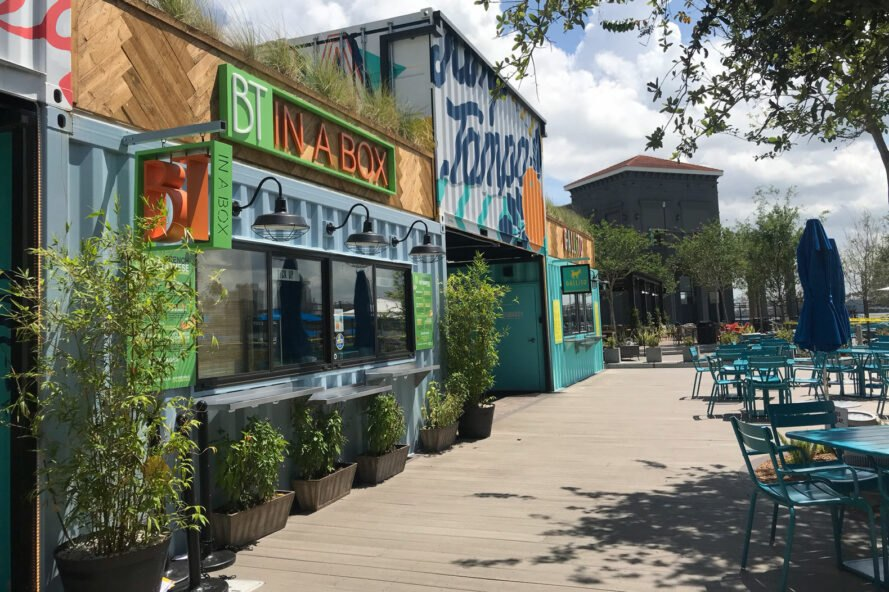 vibrant painted shipping containers turned into restaurants
