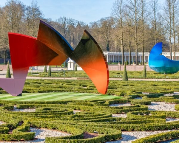 red and blue sculptures in a garden