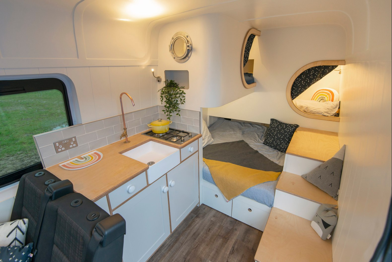 This camper van features not just one, but two sleeping pods in its cozy interior