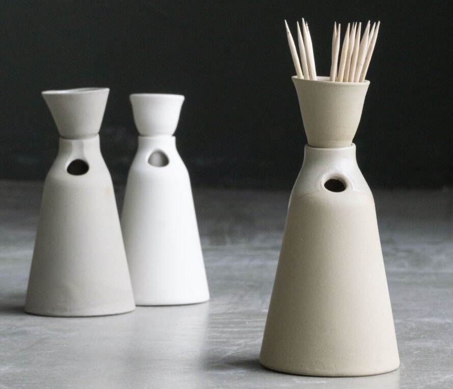 white sculptural toothpick holders