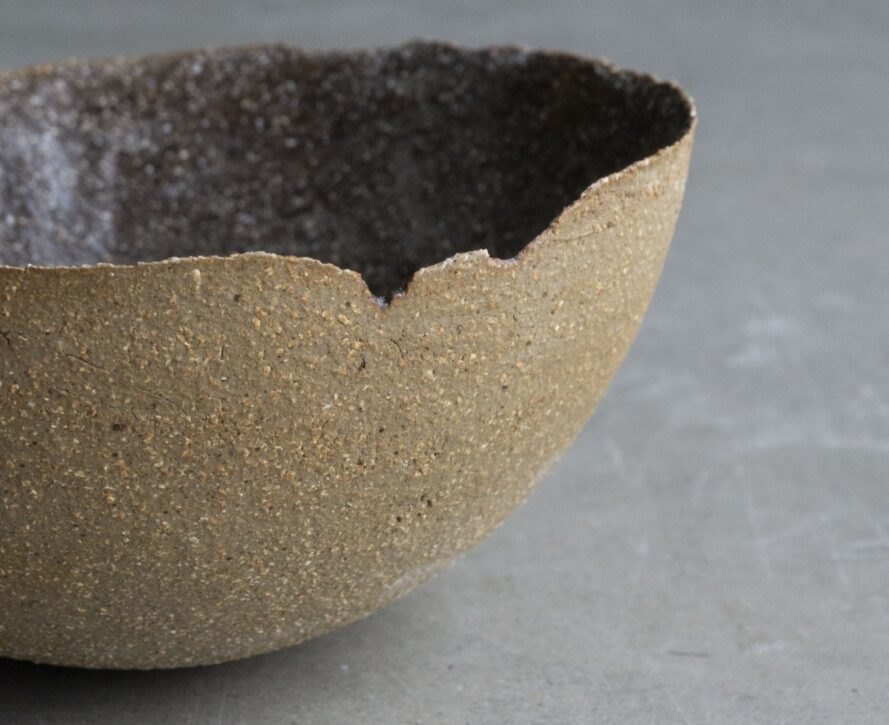 close-up of brown bowl with jagged edges