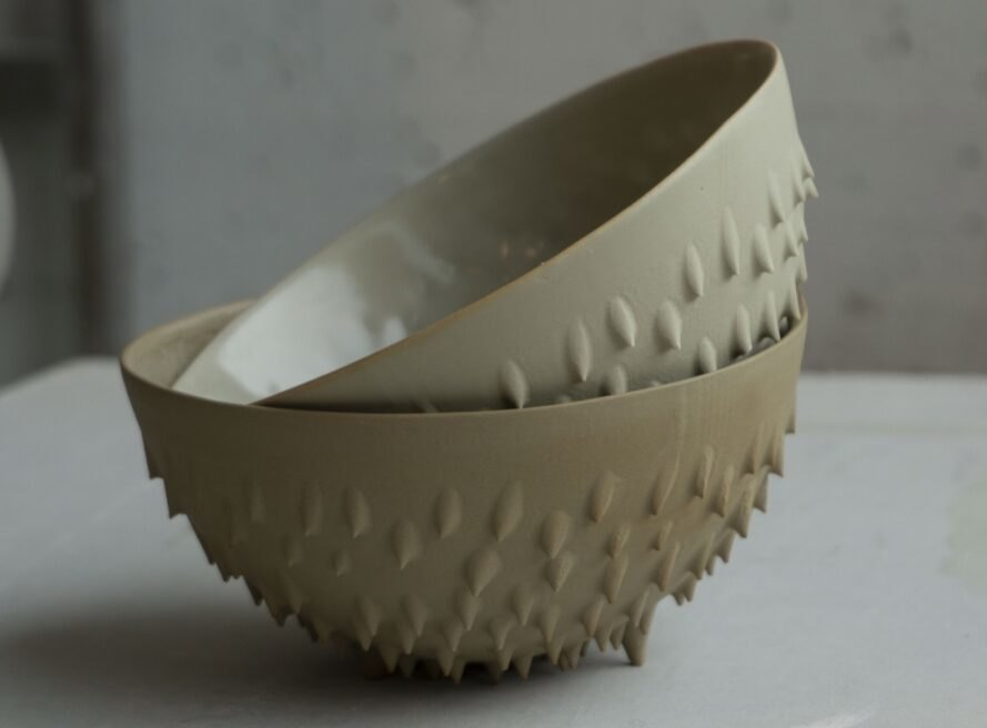 brown bowls with textured exteriors