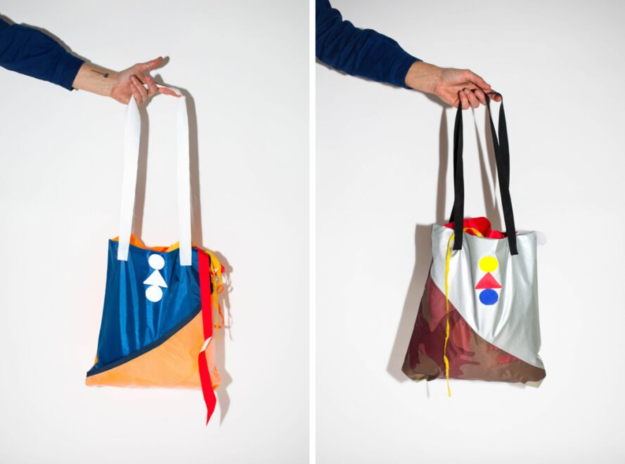 hand holding colorful bag made of recycled fabric