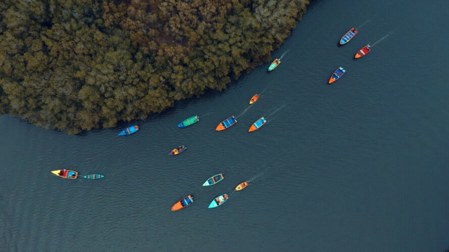 aerial view of several colorful fishing boats on the water