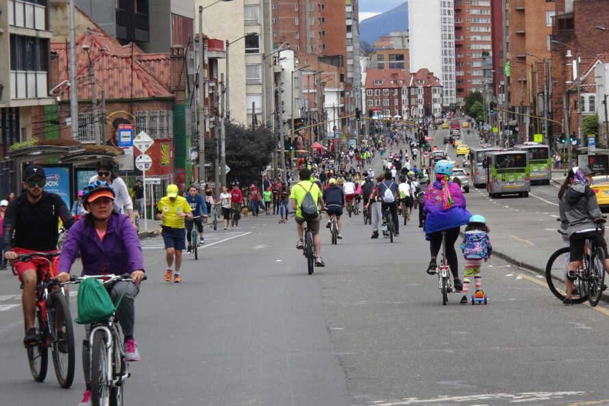 crowds of people biking and walking on empty streets
