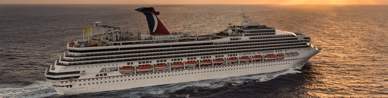 Carnival cruise ship on the ocean at sunset