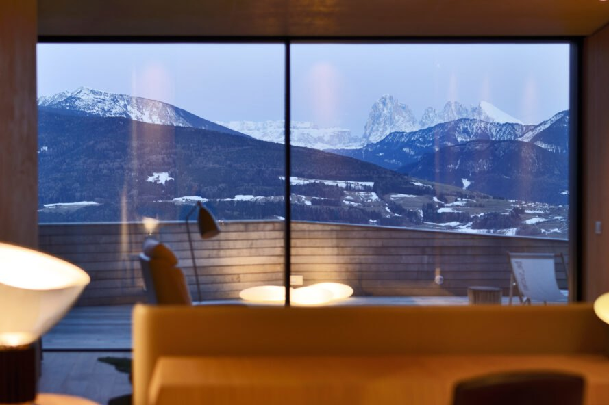 view of mountains from glass wall
