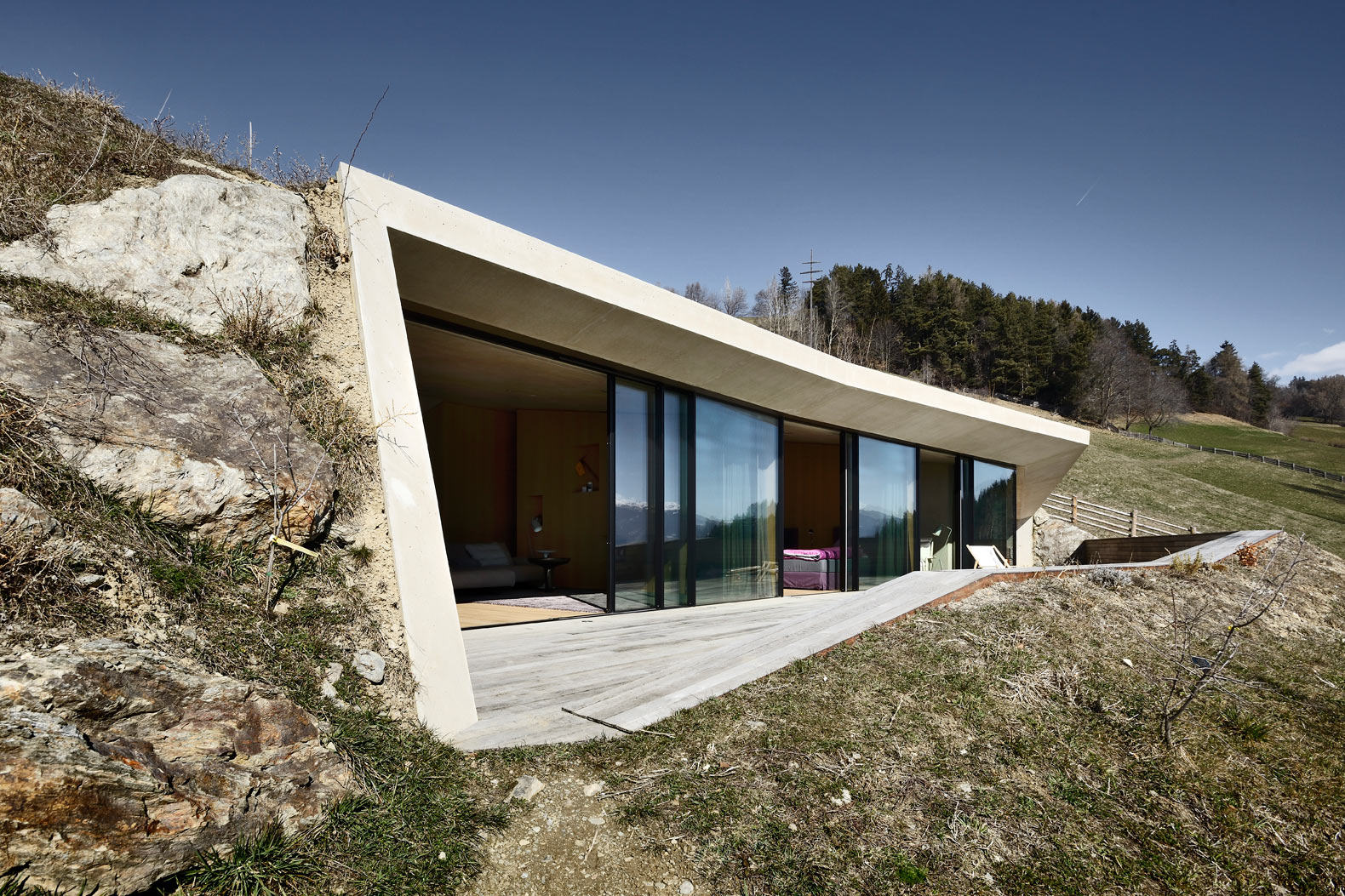 The Felderhof House in Italy is built into the ground and topped with a green roof