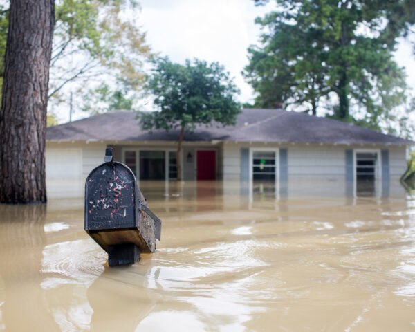 mailbox and home mostly submerged in flood waters