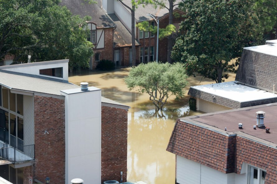 apartment buildings submerged in flood waters