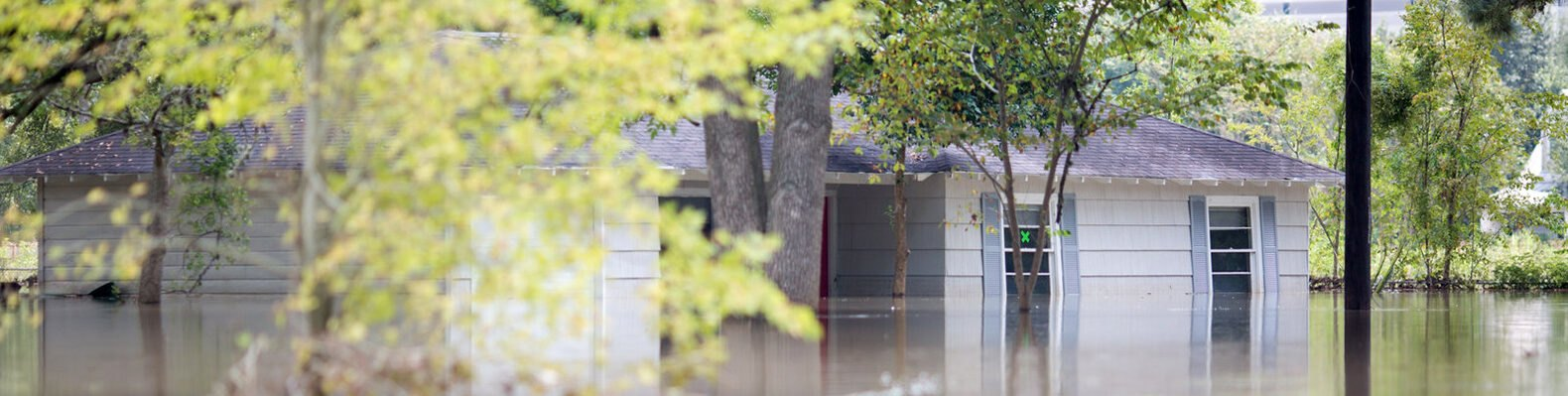 house mostly submerged in flood waters