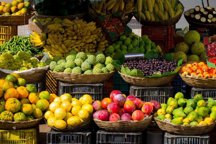 farmers' market with baskets of fresh fruit