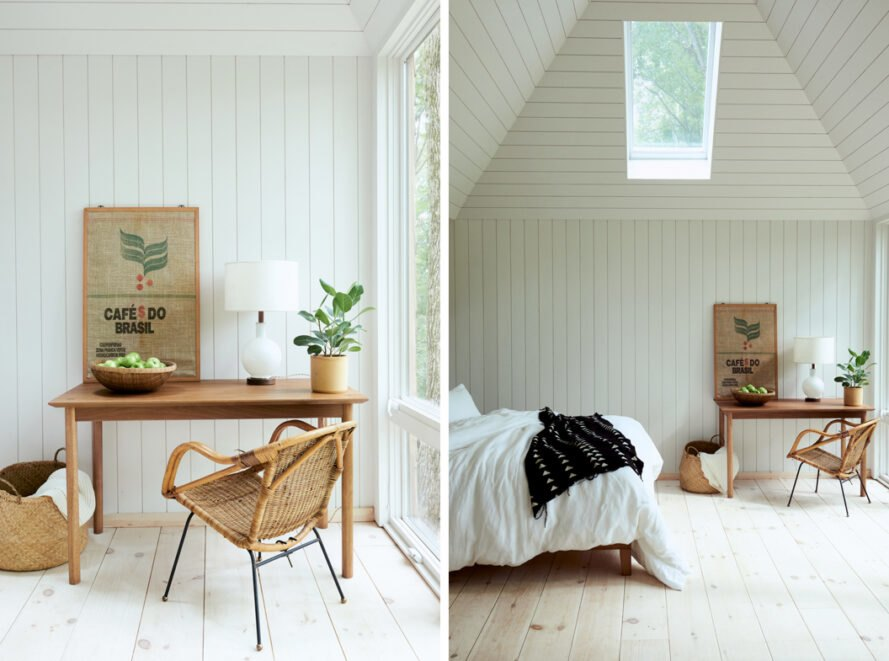 white bedroom with fluffy white bed, wood desk and a skylight
