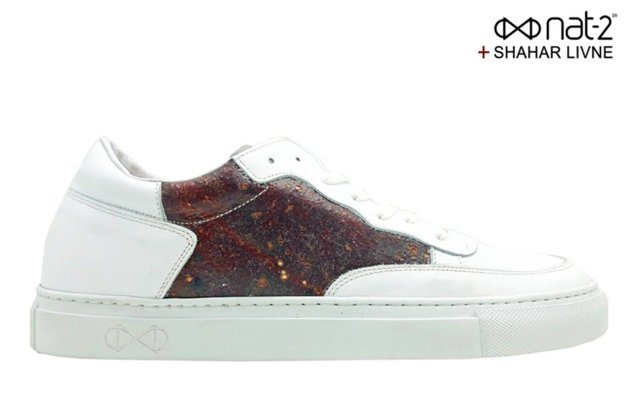 white sneaker with bloody side panel