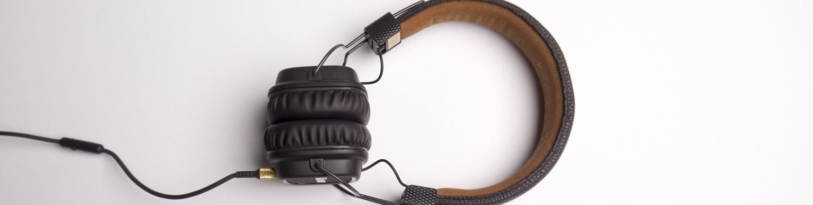 black and brown headphones on white background