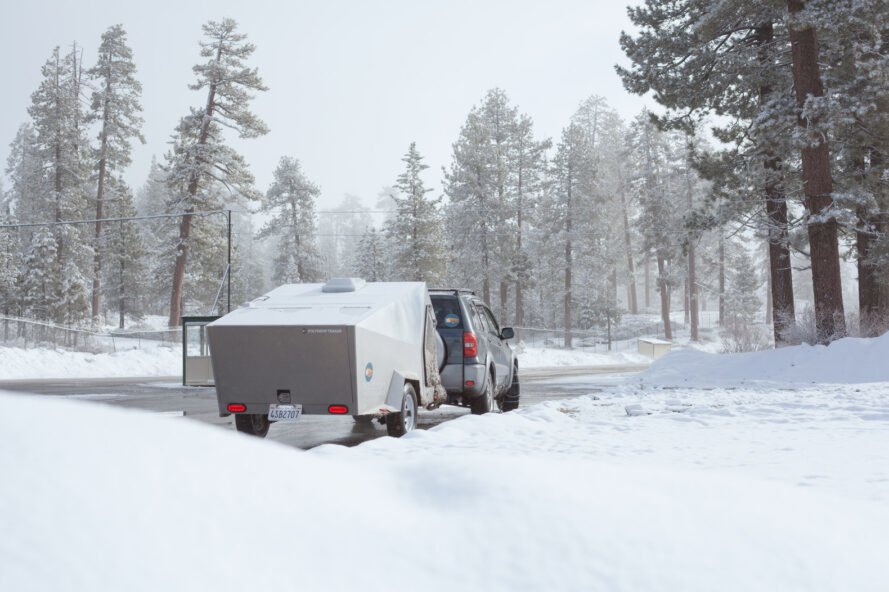 geometric metal trailer in snowy landscape