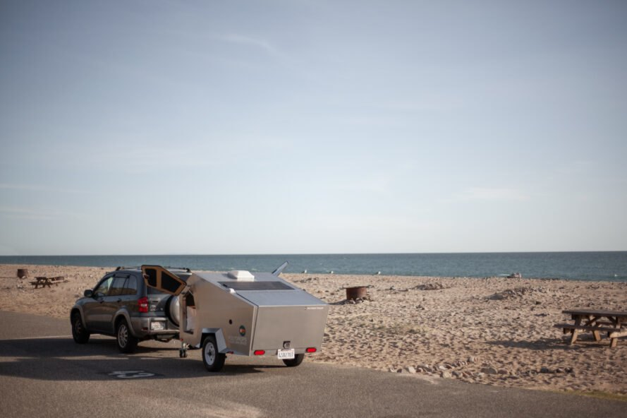 geometric metal trailer by the beach
