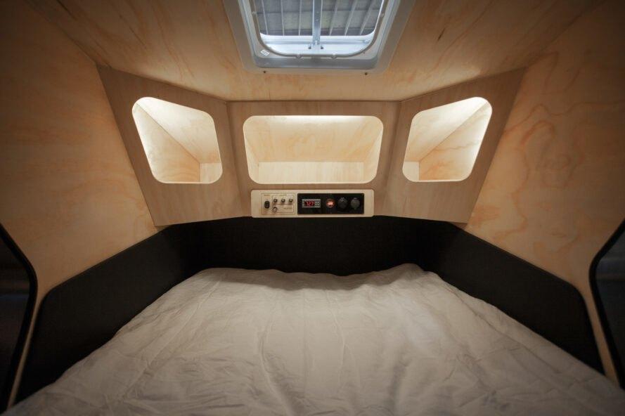 interior of geometric trailer with wood walls and built-in cubbies