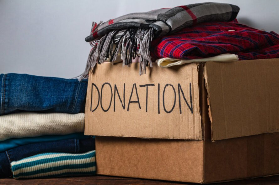 donation cardboard box with clothing and blankets