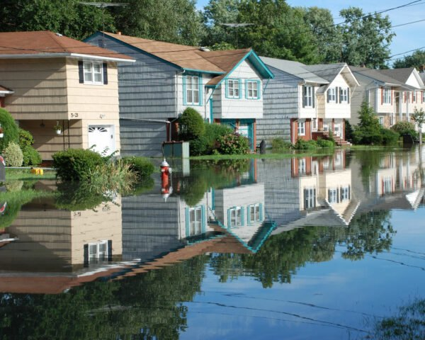colorful houses partially submerged in flood waters