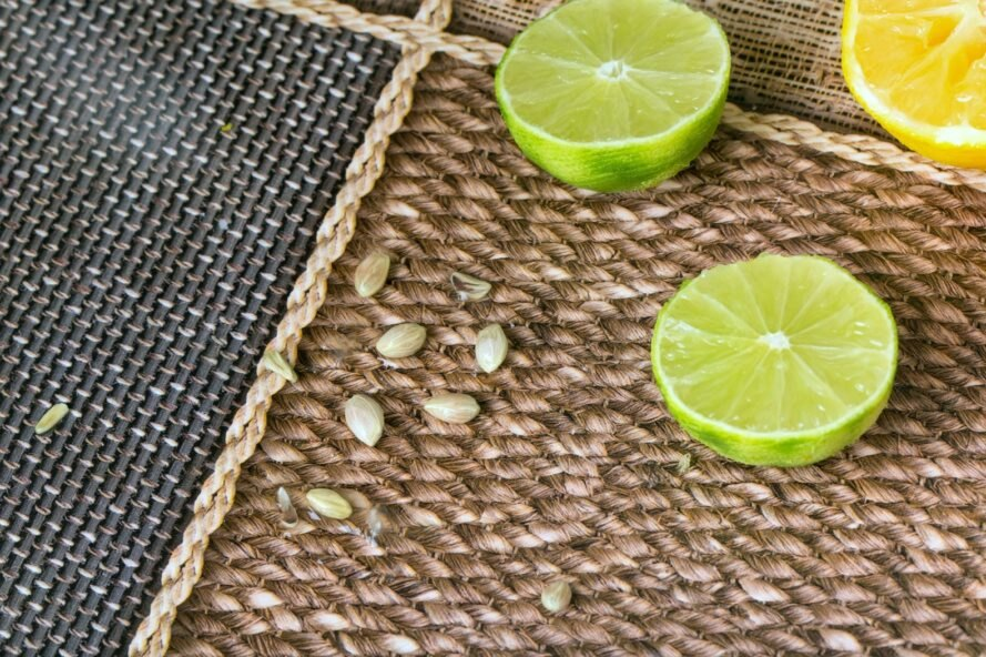lemon and limes and their seeds on burlap