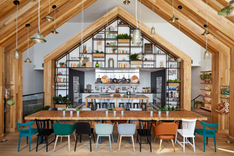 communal kitchen with wood gable shapes and multi-colored bar seats