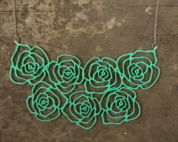 a green flower necklace