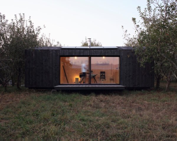 black horizontal cabin with sliding glass doors