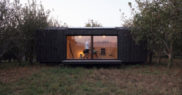Beautiful solar-powered minimalist cabins are clad in locally sourced charred timber