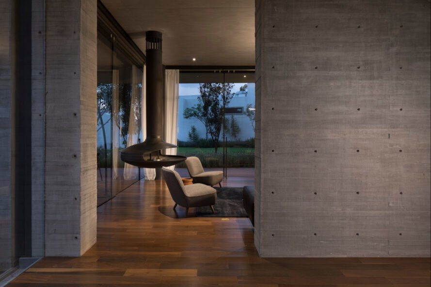 interior living space with concrete walls and wooden flooring