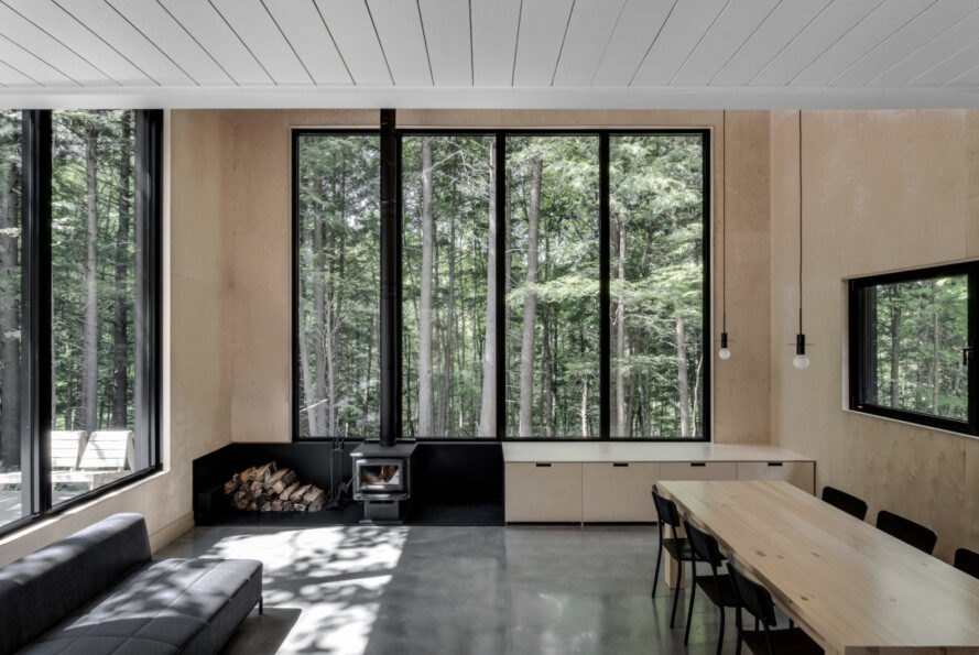 interior living space with four slender windows and a wood-burning chimney