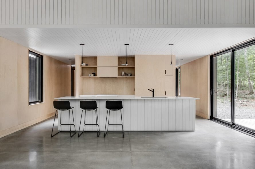 contemporary kitchen with bar stools in front of white kitchen island