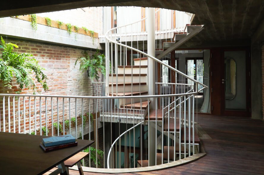 spiral staircase leading to open-air courtyard