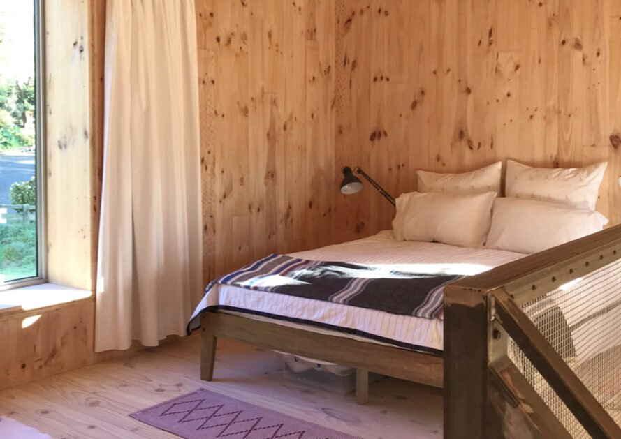 bedroom inside tiny cabin