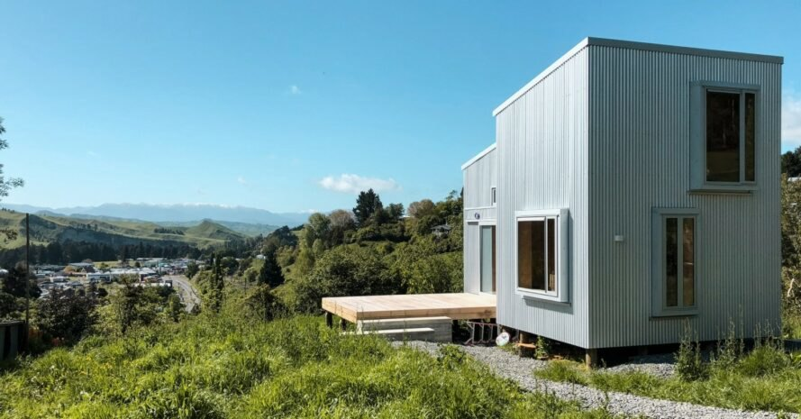 tiny cabin clad in corrugated metal with large window