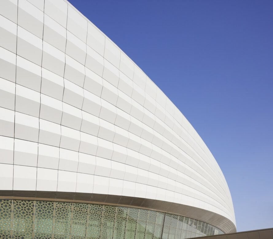 long building with curved white roof