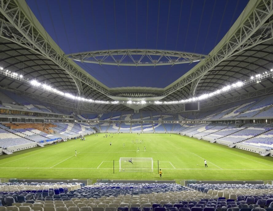 soccer stadium below open roof