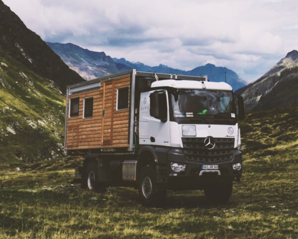 wooden motorhome parked in mountainous area