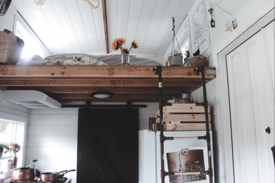 ladder leading up to sleeping loft in tiny home
