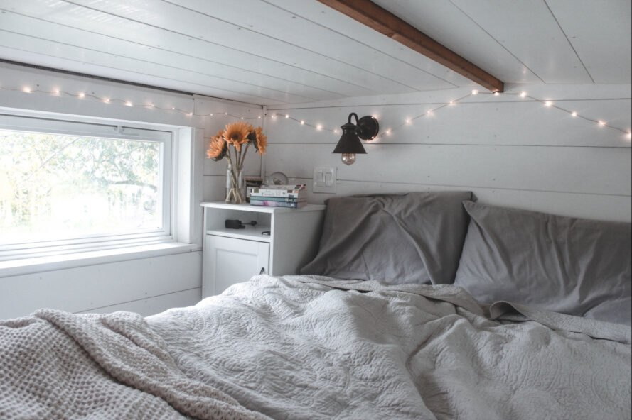 bed in sleeping loft in tiny home