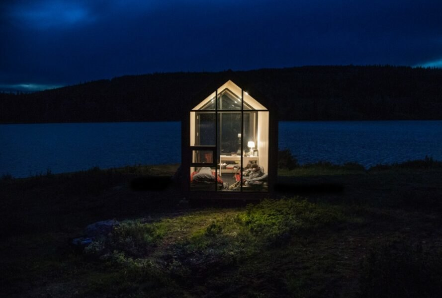 tiny cabin with pitched roof and glass walls
