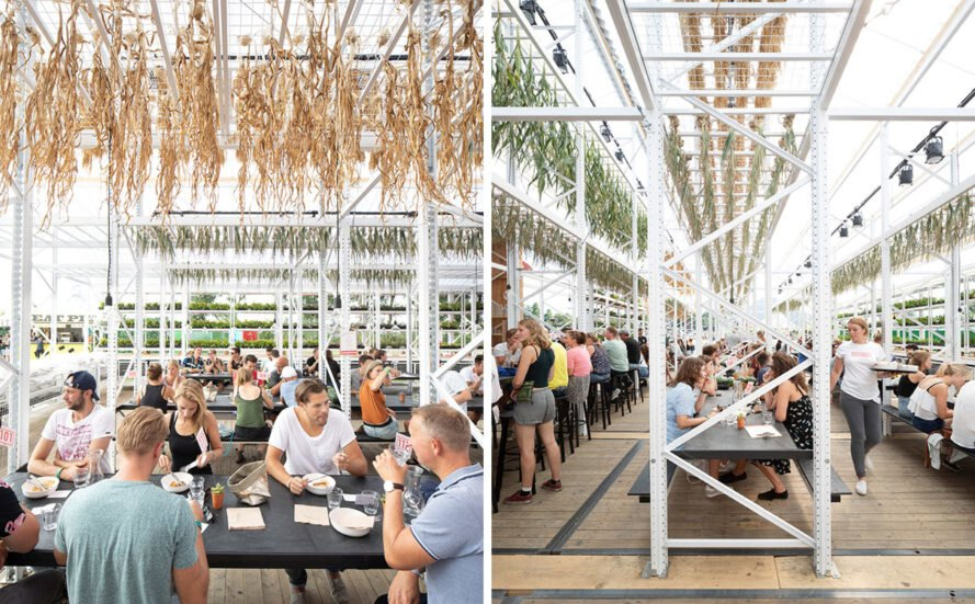 people dining in open-air pavilion with foods hang-drying above them