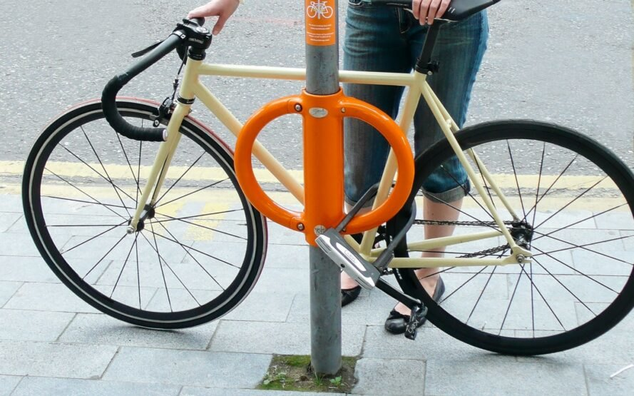bike locked to street pole with orange lock