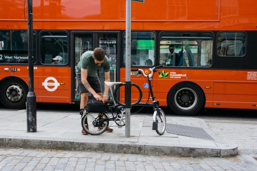 man locking his bike to street pole