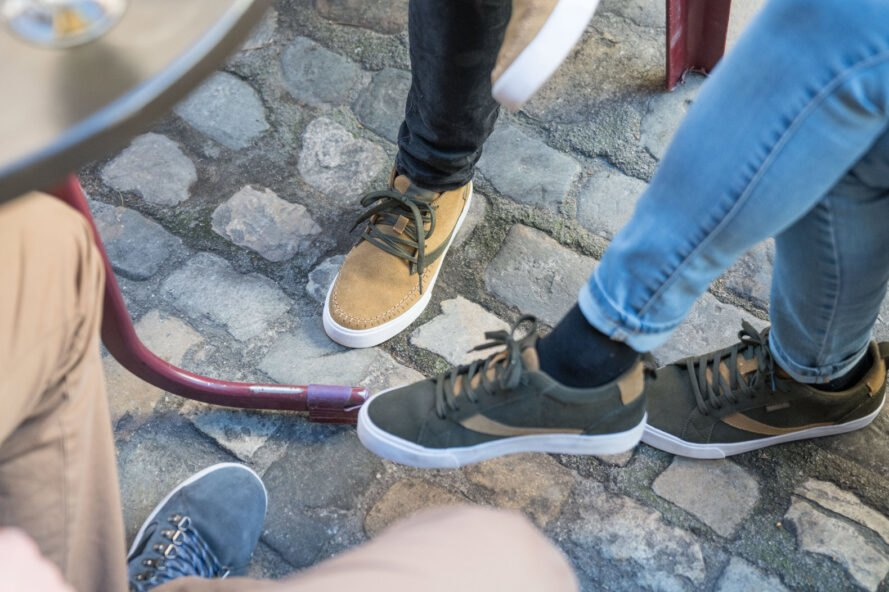 group of people wear light brown, green and blue shoes