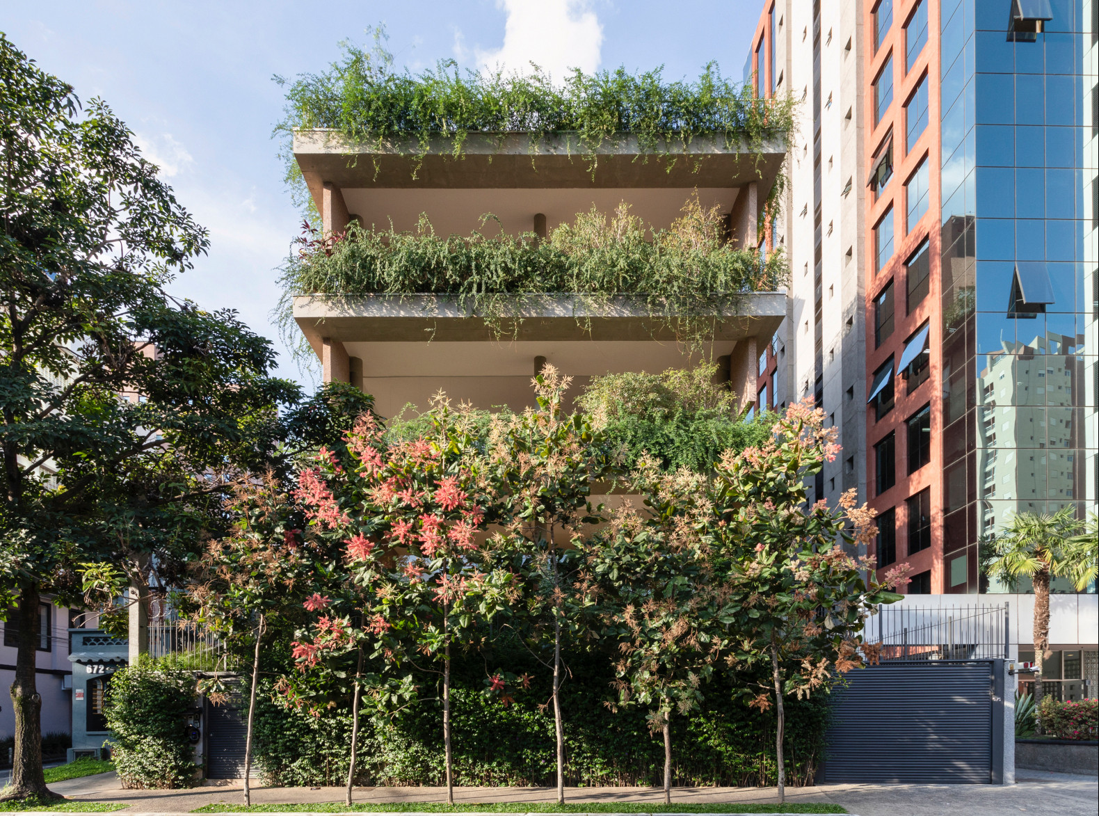 Architects transform a residential building into a lush, green oasis in the heart of São Paulo